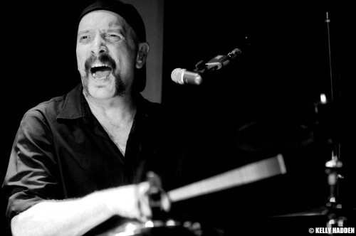 Frank Funaro plays the drums